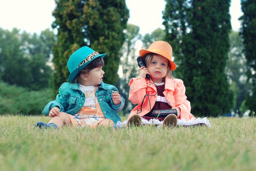 Two kids playing outside together.